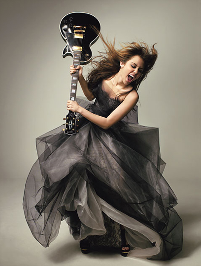 0401-miley-cyrus-raising-guitar_lg